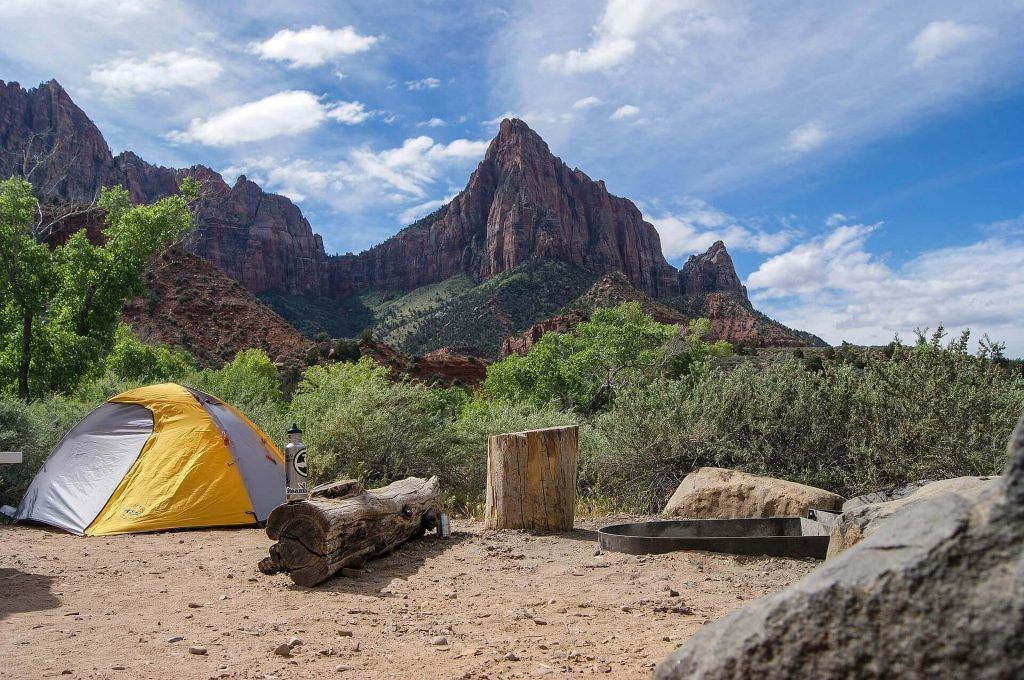 Camping near a beautiful scenery of red rock formations (Tent camping)
