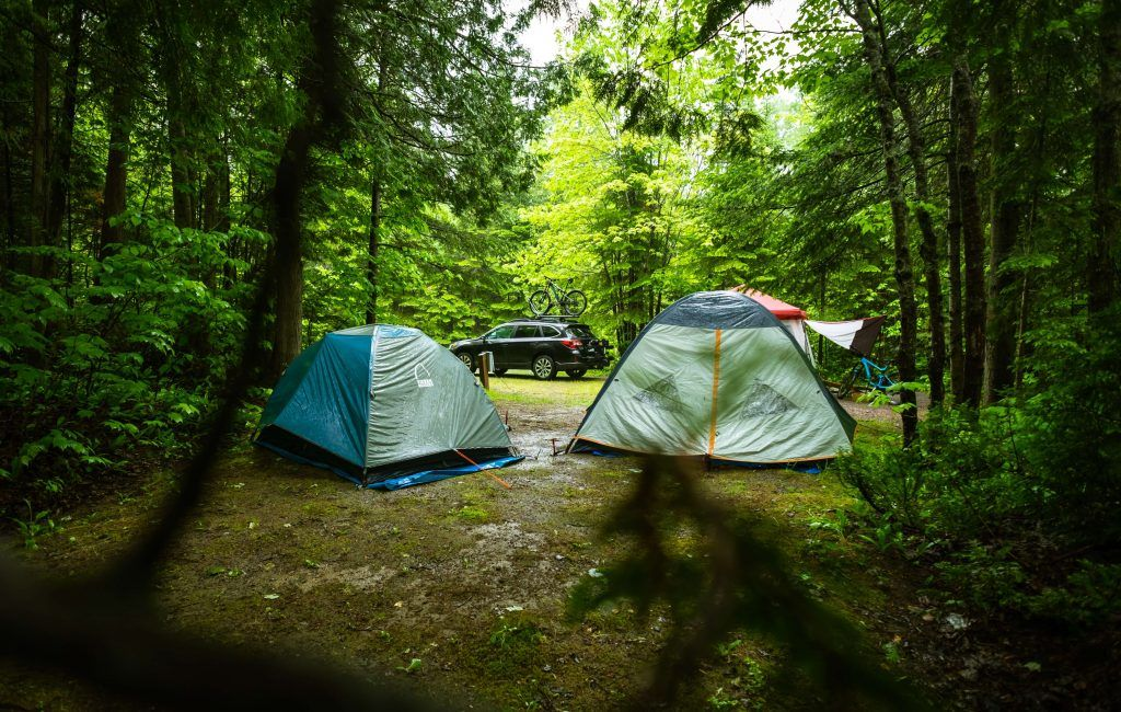 Car camping in the wilderness with tents (types of camping)