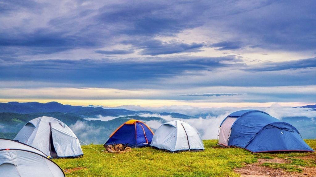Adventure camping with a group of trekkers